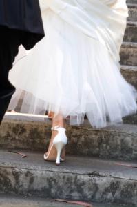 Bride climbing steps